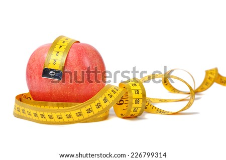 Red apple and measure tape over white - stock photo