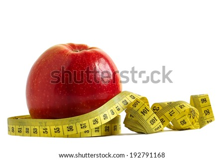 Red apple and measuring tape over white background - the concept of diet and fitness