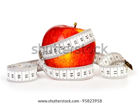 Red apple and tape measure isolated on white - stock photo