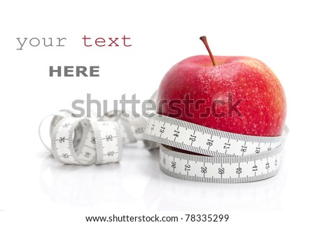 Red apple and tape measure isolated on white (with sample text) - stock photo