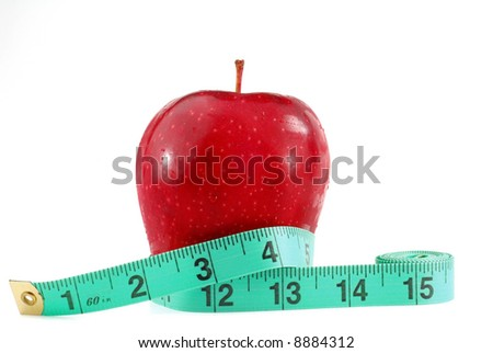 Red apple and tape measure placed on the table