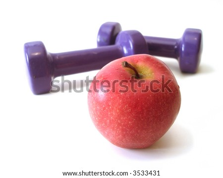 red apple and violet rubber dumbbell over white background - stock photo