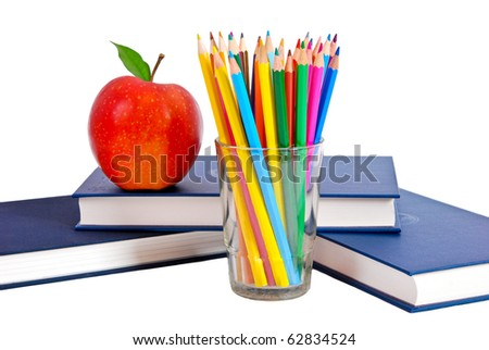 Red apple, books and colored pencil