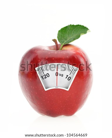 Red apple diet and weight loss scale concept