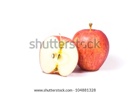 red apple fruits with cut isolated on white background