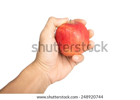 red apple in a male hand isolated on white background. - stock photo