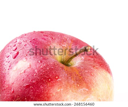 red apple in a spray of water on a white background - stock photo