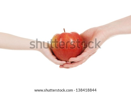 red apple in child and mommy hands isolated