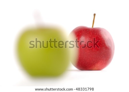 Red apple in focus and green apple out of focus isolated on white background - stock photo