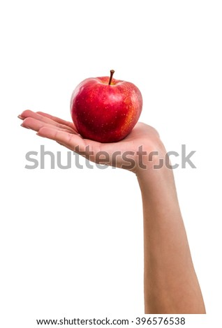 Red apple is lying in the palm, isolated on white background