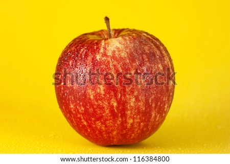 Red apple isolated on yellow - stock photo