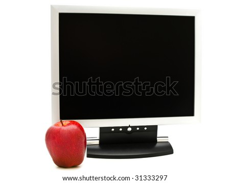 red apple near the monitor against white background