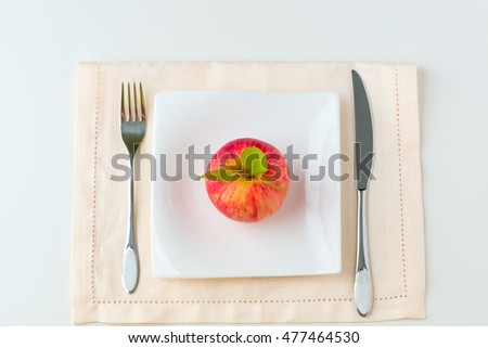 Red apple on a plate. Diet concept.
