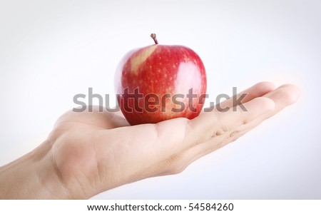 Red apple on man hand over white background. Concepts: Nutrition, Food, Health & Wellness