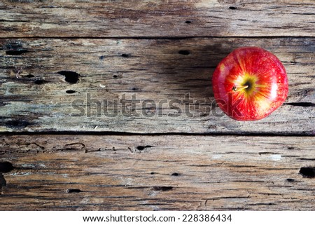Red apple on old wooden table  - stock photo