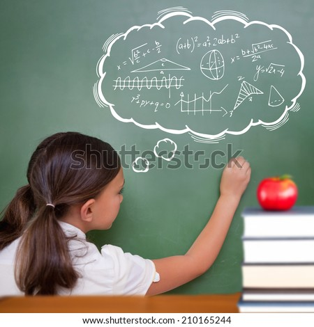 Red apple on pile of books against cute pupil writing on chalkboard - stock photo