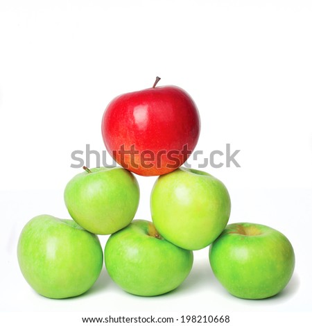 Red apple on top of a pyramid of green apples, isolated - stock photo