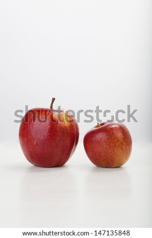 red apple on white background, with selective focus