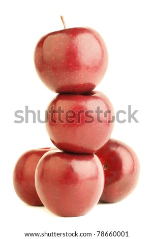 Red apple pile pyramid. Fresh fruit apples isolated on white background - stock photo