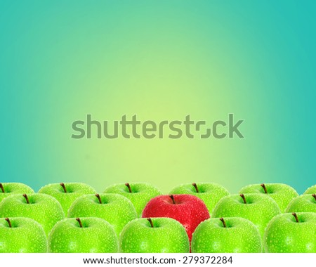 red apple place on retro green background among green apple with water droplet , unique or different concept - stock photo
