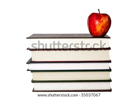 Red apple resting on top of a pile of books