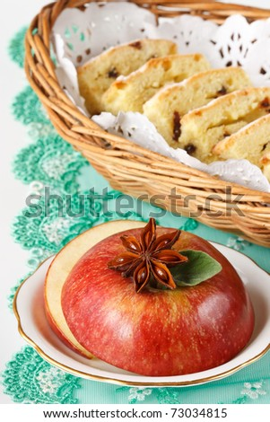 Red apple , star of anise and fruitcake.