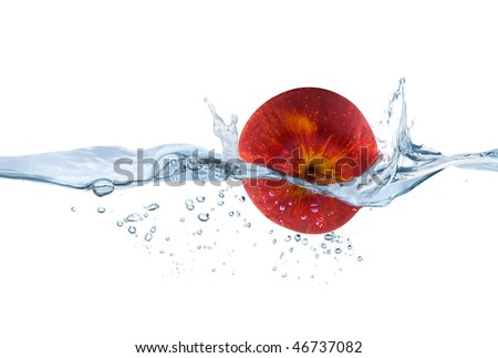 red apple thrown into the water - stock photo