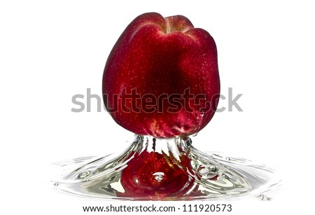 Red apple water splash with white background, high speed splash