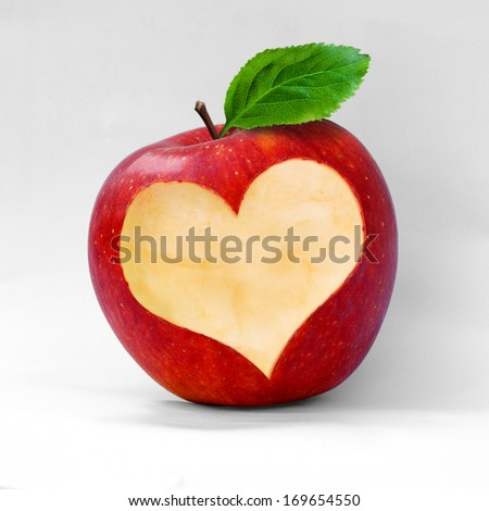 Red apple with a heart shaped cut-out. - stock photo