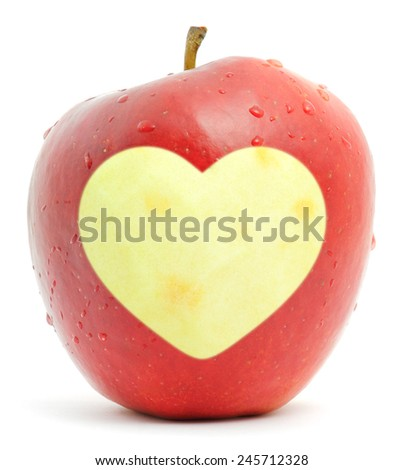 Red apple with a heart symbol isolated on white - stock photo
