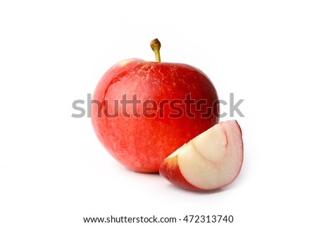 red apple with a slice cut isolated on white background