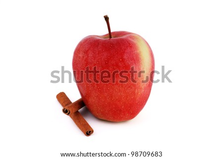 red apple with cinnamon on a white background