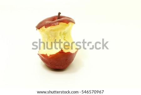 Red apple with green leaf missing a bite isolated on a white background.