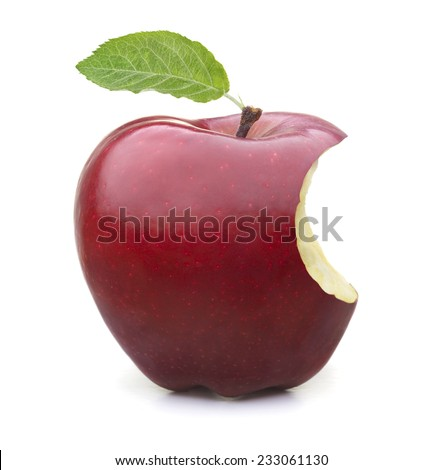 Red apple with green leaf missing a bite on white background. - stock photo