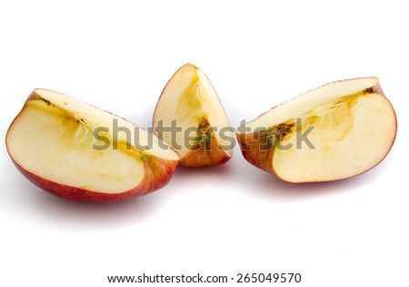 Red apple with leaf and slice on a white background.