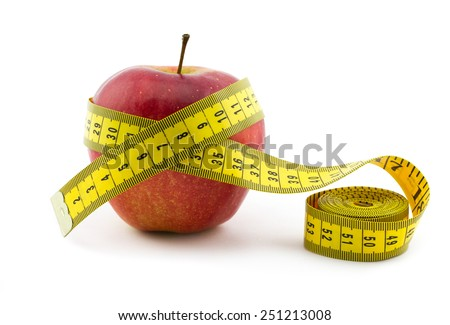 Red apple with measuring tape isolated on white background. Healthy lifestyle concept - stock photo
