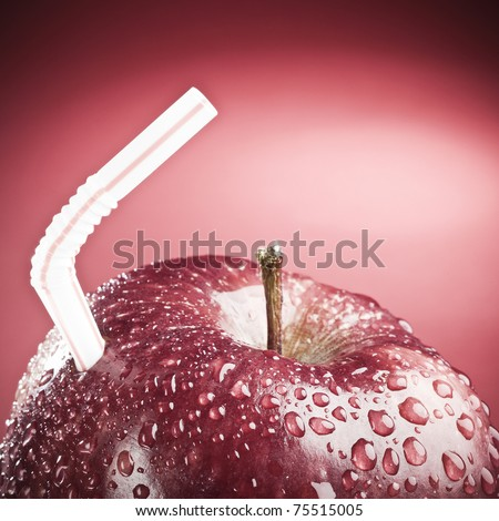 Red apple with straw, like a fruit juice !