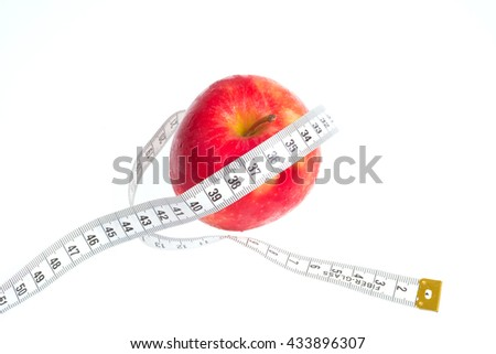 Red apple with tape on white background