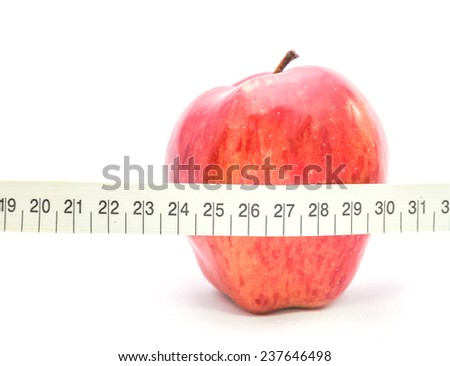 Red apple wrapped with a tape measure,on white background