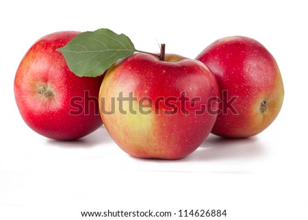 Red apples fruit with leafs on white background - stock photo