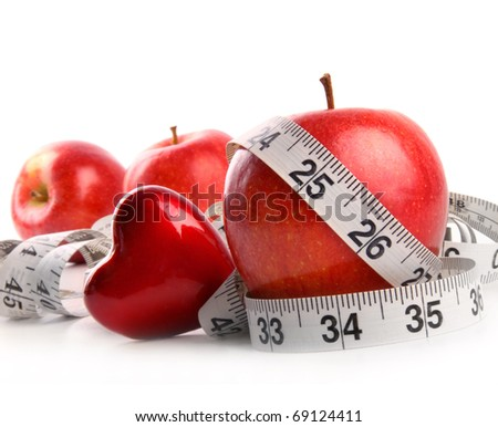 Red apples,heart and measuring tape on white background - stock photo