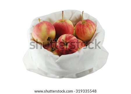 Red apples in a cloth bag on white background
