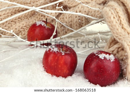 Red apples in snow close up - stock photo