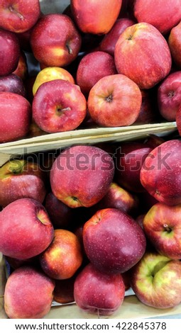 Red apples in the boxes