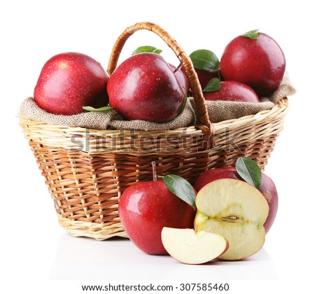 Red apples in wicker basket isolate on white - stock photo