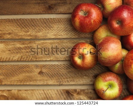 Red apples in wooden box. Copyspace - stock photo