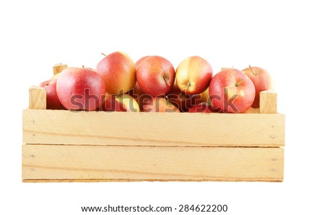 Red apples in wooden box isolated on white
