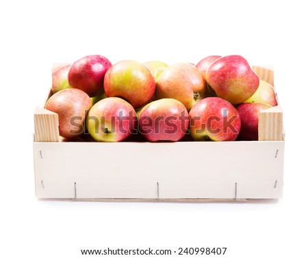 red apples in wooden box isolated on white background
