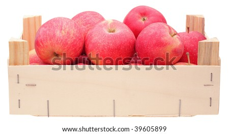 red apples in wooden box on white background
