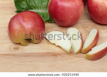 red apples is delicious on wood background